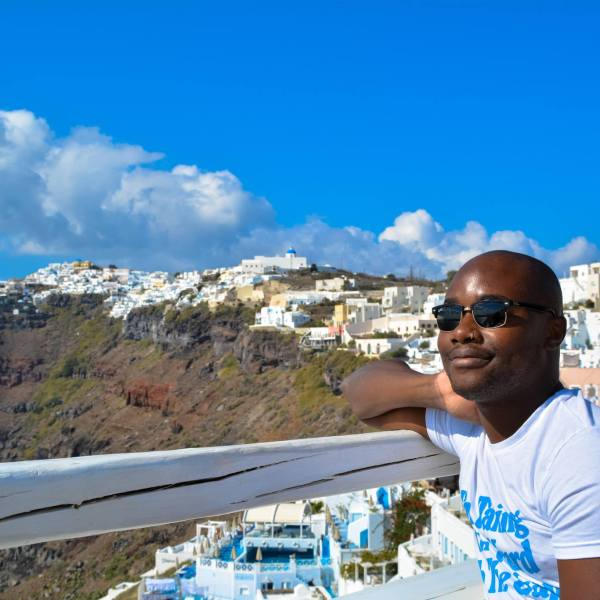 Pondering Life's Great Questions... Yaya in Santorini, Greece