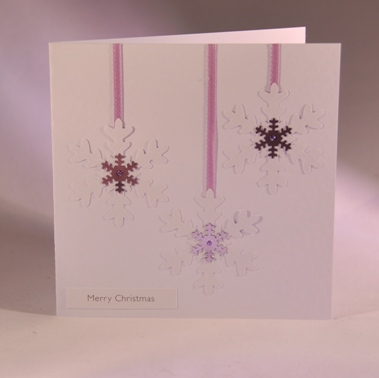 A Handmade Christmas Card With Snowflakes Handmade By Helen