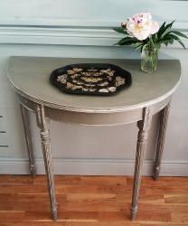 Half-moon console table; distressed