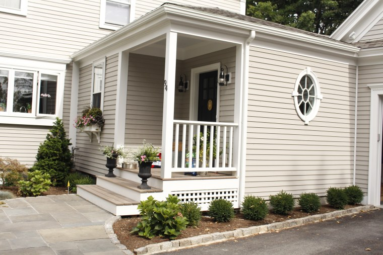 Covered porch creates welcome entry space