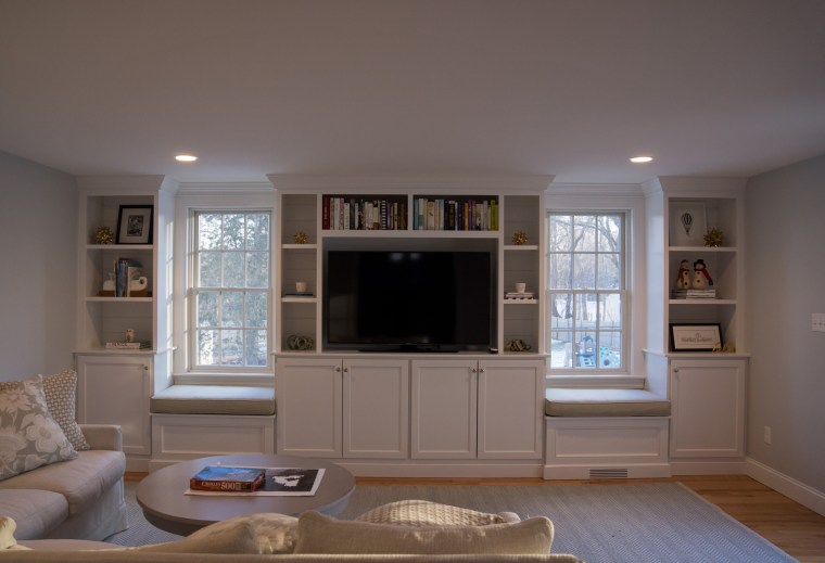 Optimize storage while creating custom cabinets in built-in media center and seating area