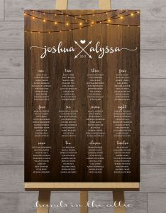 Image of vertical wedding seating chart with string lights also hands in the attic rh handsintheattic