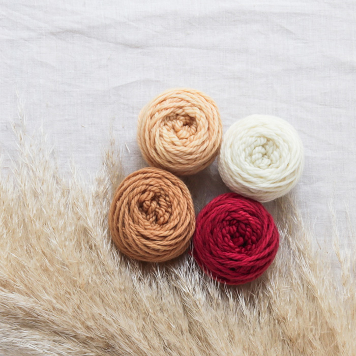 naturally dyed woollen yarn in brown & red tones
