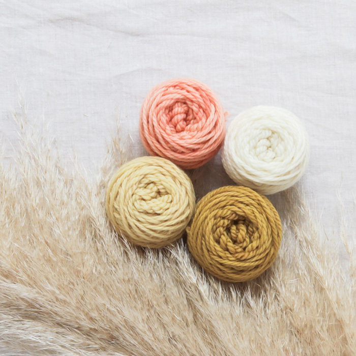 naturally dyed woollen yarn in pink & yellow tones