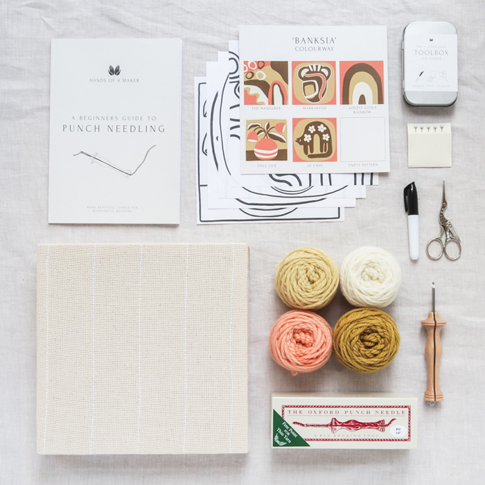 punch needle kit flat lay of all tools and materials needed to create artwork