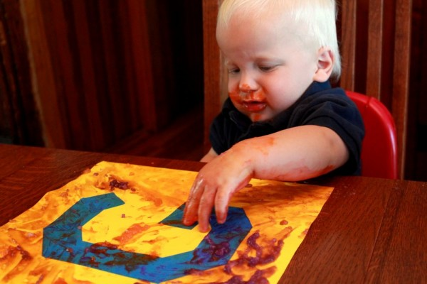 Homemade edible finger paint to make tape resist art with toddlers