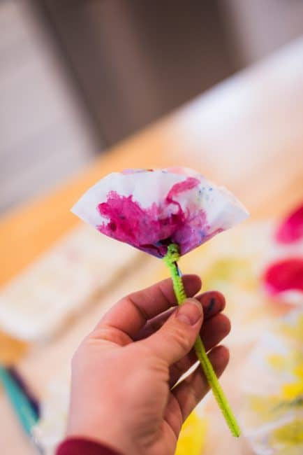 Just a few twists with a pipe cleaner and voila - a pretty coffee filter flower for kids to make for Mother's Day!