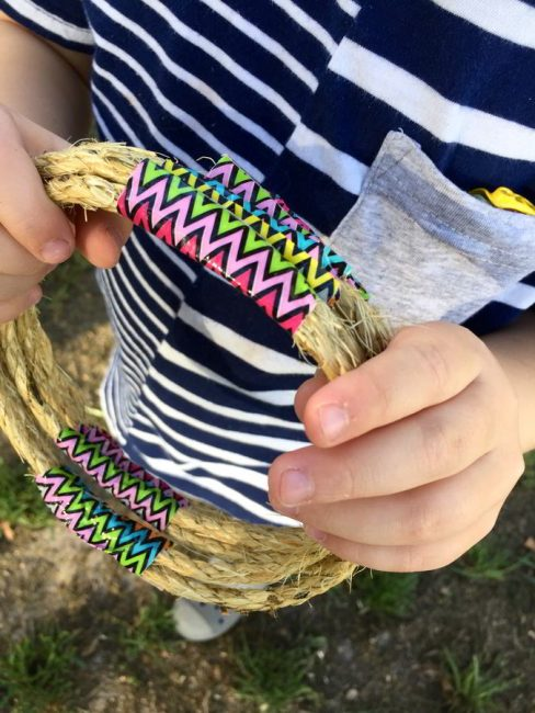 Make this simple DIY nature ring toss game! This outdoor play idea is simple and fun!