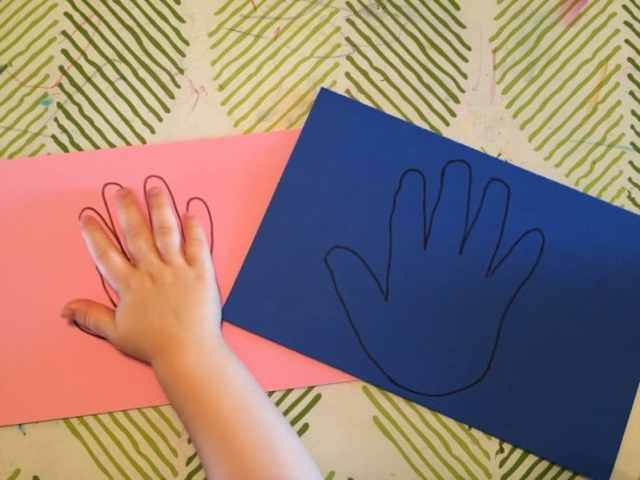 Trace your child's hand onto foam.