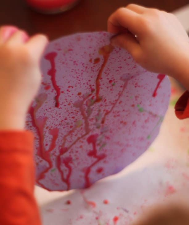 Try painting with toothbrushes and plain old gravity for a creative art activity!