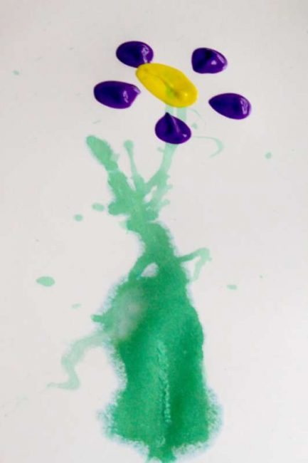 A creative spring flower art project for kids to make - straw painting and bottle prints! Fun!