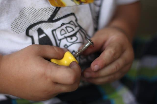 Toddler Fine Motor Activity with Knobs & Screws