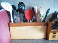 A utilitarian kitchen utensil holder thats easy on the ...