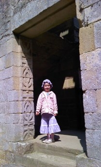 A carved doorway & a cute girl