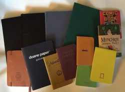 A large group of notebooks and journals