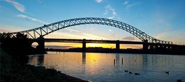 Grab hire Widnes. A picture of the old Widnes Bridge