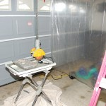 Handyguy Paul set up an area in his garage to cut the tiles. He borrowd the saw. The plastic curtain kepts the mess contained.