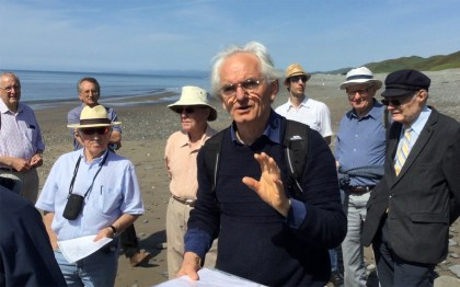 Michael Freeman talks about ruins along Llanrhystud seashore.