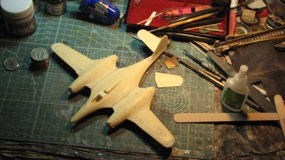Here the airframe is nearly complete, with the Milliput sanded smooth along the join with the engine nacelles, and the outboard wing sections and one of the elevators attached.