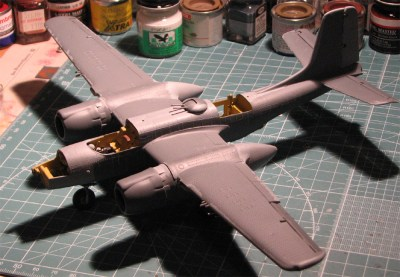 Construction has progressed to the point that the plane is ready for airbrushing in semi-gloss black. Note the touch-up to the primer and the ball bearings in the cockpit to make the A-26 rest properly on its tricycle landing gear.