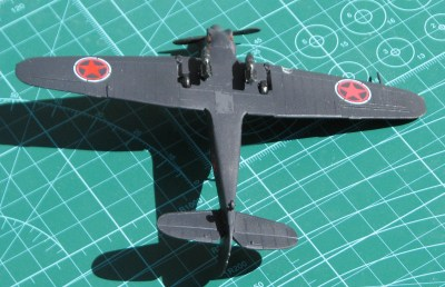This view of the belly shows the bombs to good effect; the decal on the left was damaged upon application and had to be painted over with Humbrol Red Madder. Ironically, the damaged marking shows up better on film. The rectangle in the center of the wing is painted Tamiya tape covering the hole cut in the belly for the display stand.