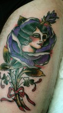traditional tattoo ose lady in a rose
