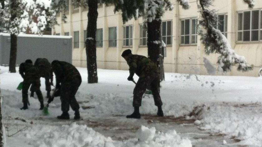 My husband took this photo while he was shoveling snow in the army--junior officers have to do their duty too!