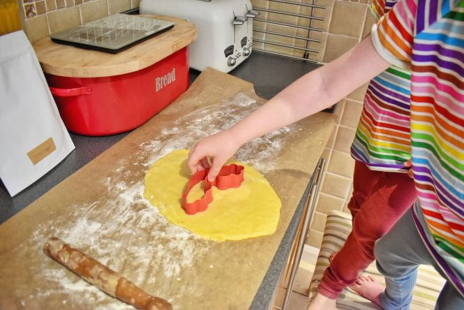 cutting out rainbow biscuits with Little Star Baker eco-friendly home baking kits