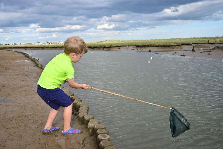 Boy crabbing in Walberswick