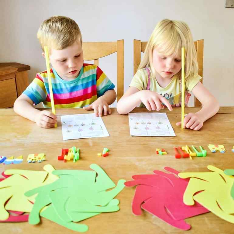 Twins making windmills with craft kit