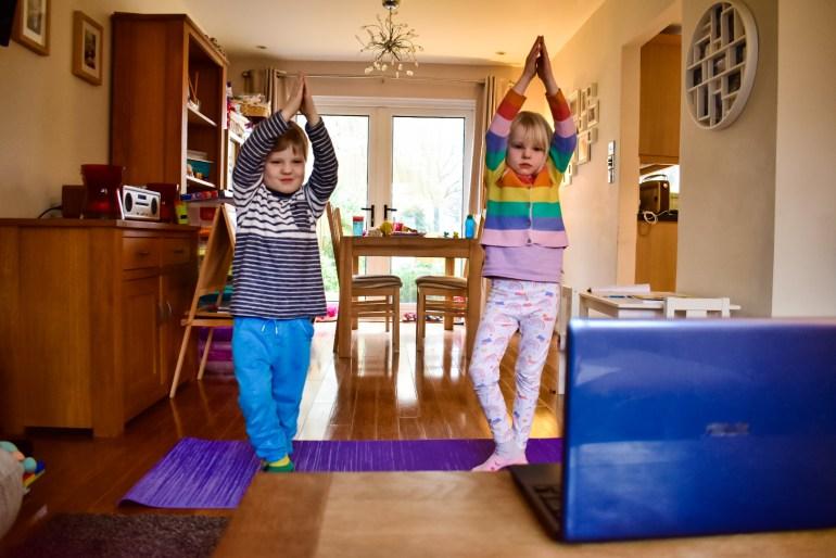 children doing yoga while self isolating