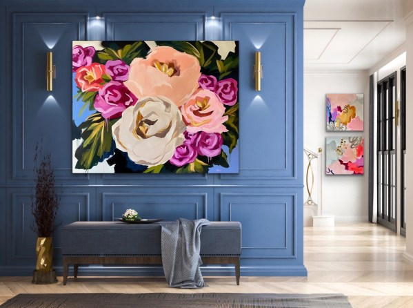 commissioned large scale acrylic painting of bold colorful abstract florals displayed in an elegant high end room on a blue wall by Dallas, Texas artist Hannah Brown