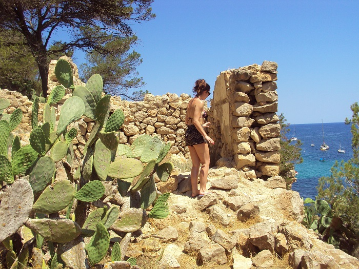 Girl by wall near sea Ibiza