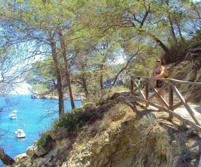 Girl stood on bridge near ibiza sea