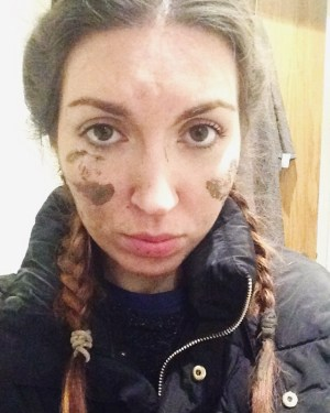 Girls face covered in mud