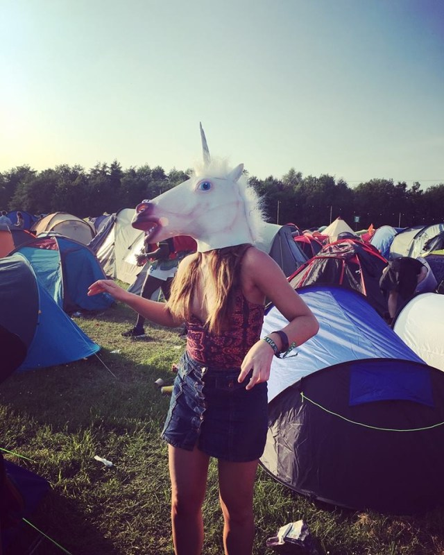 girl at festival with unicorn head