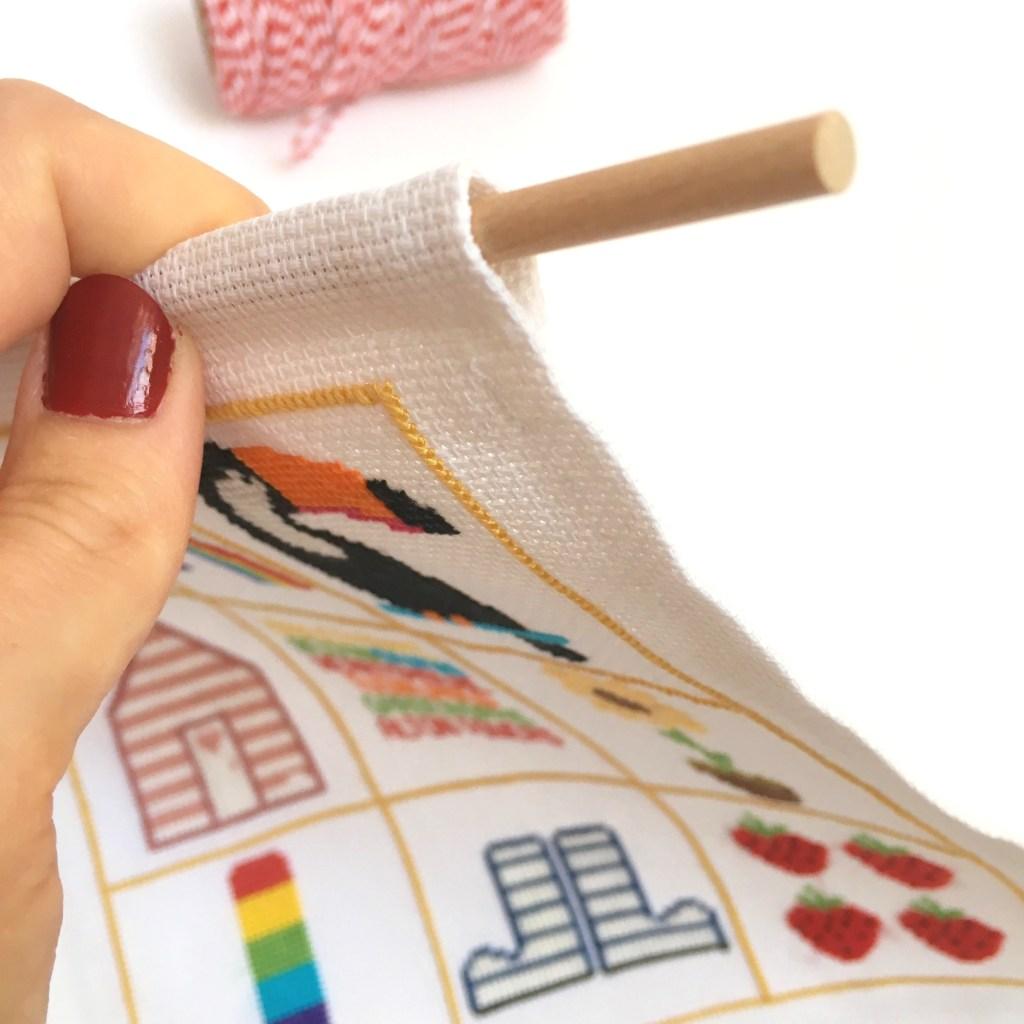 wooden-dowel-on-cross-stitch-banner