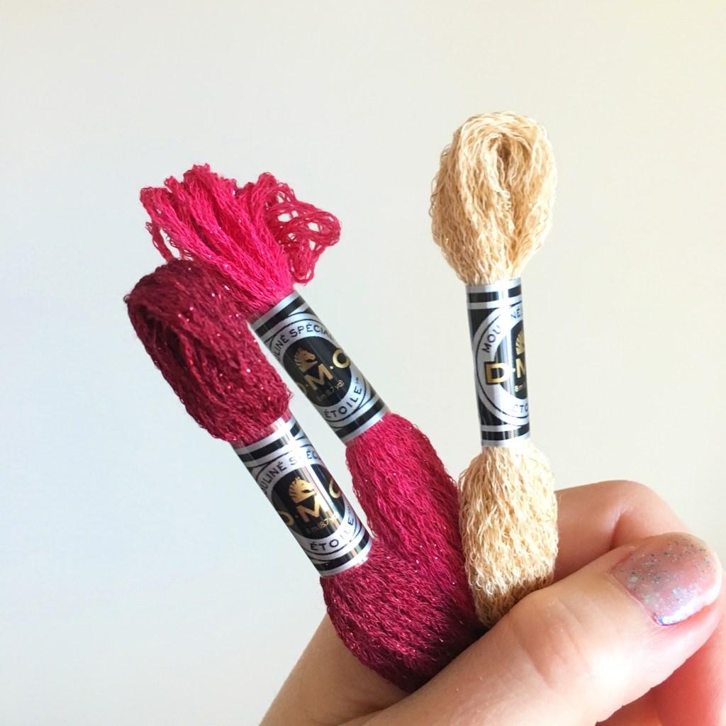 hand-holding-dmc-etoile-threads
