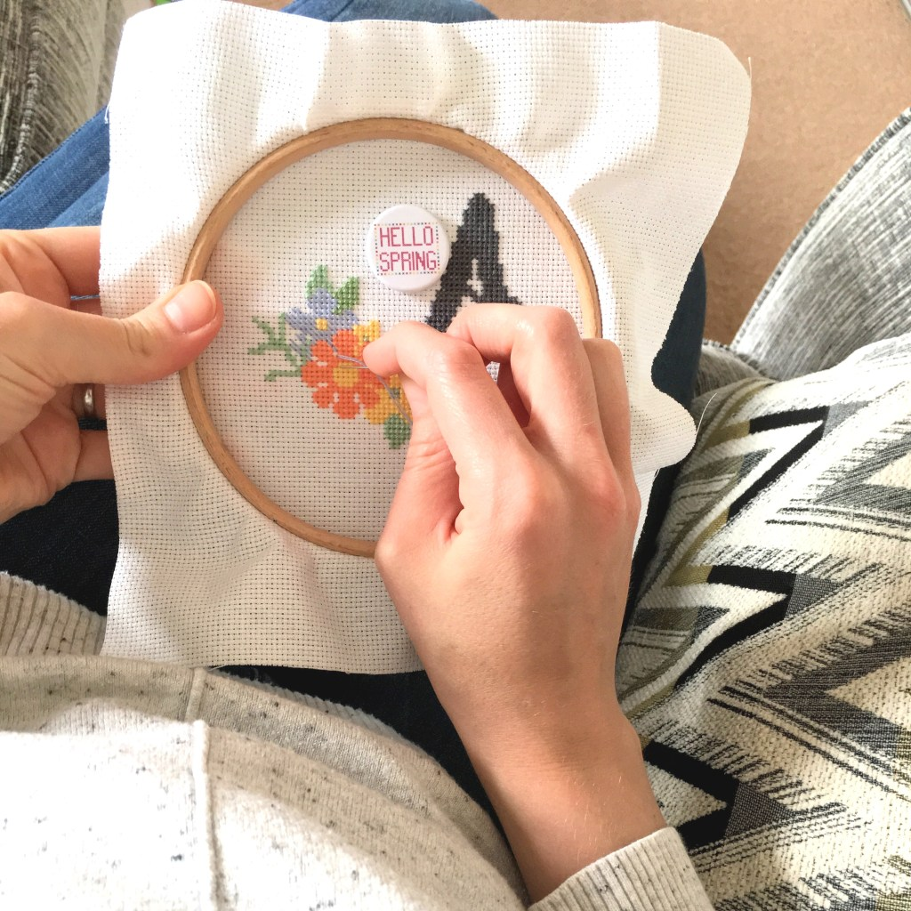 girl-stitching-a-cross-stitch-hoop