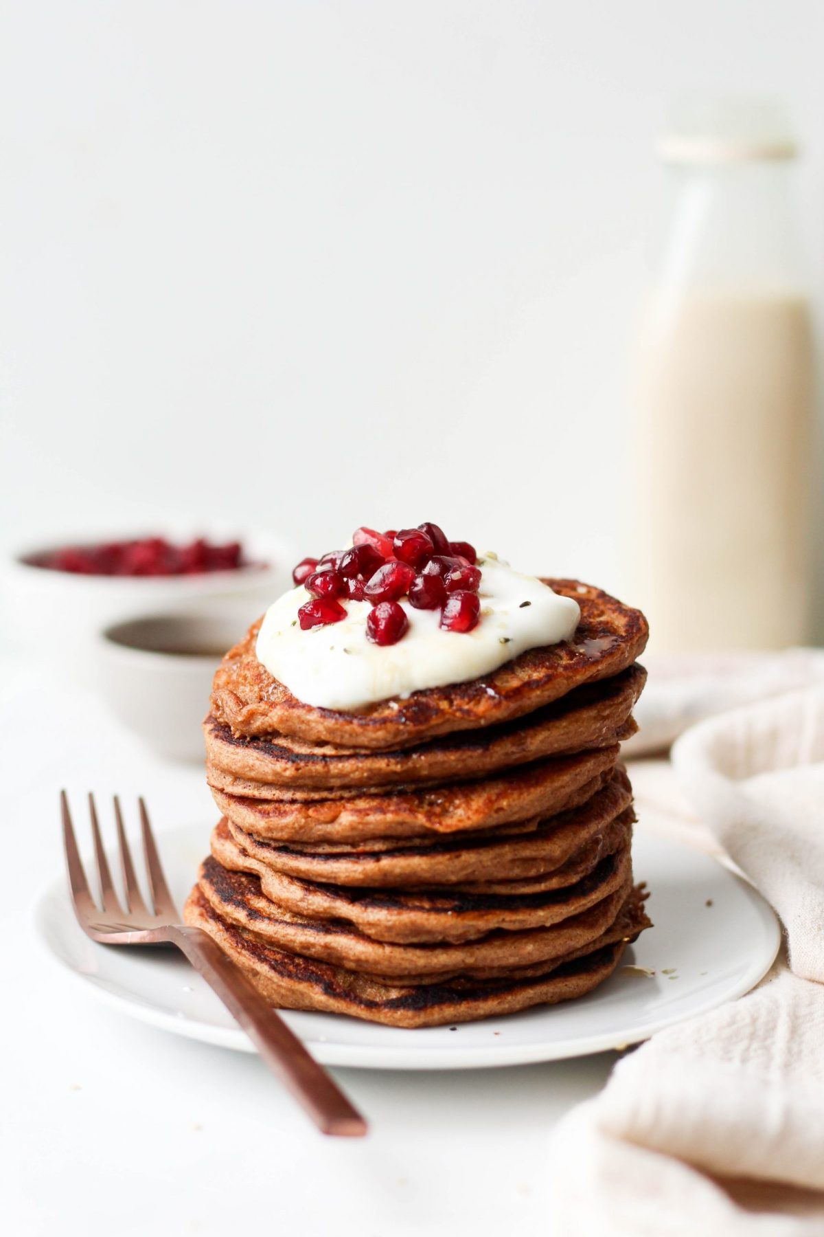 These healthy Buttermilk Gingerbread Pancakes are the ultimate holiday breakfast! Make them on Christmas morning or whenever you want to feel festive. They're fluffy, vegan and made with whole wheat flour!