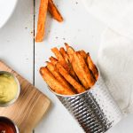 Baked Sweet Potato Fries are simple to make and the perfect healthy side dish for any meal. Pair with easy and delicious homemade curry mayo!
