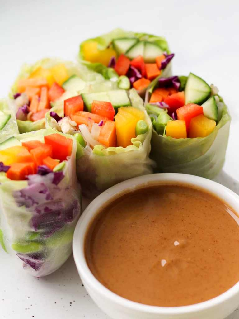 These fresh & healthy Vegetarian Rice Paper Rolls are full of veggies, flavour and crunch. They make a great light, no-cook meal, or snack to share. Vegan and gluten-free!
