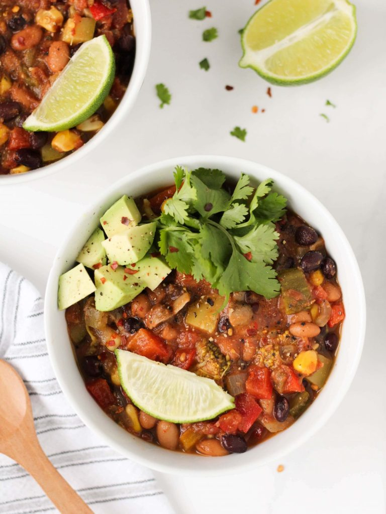 This vegetarian chili is packed with plant-based protein and loaded with veggies. It's perfect for those chilly days when you want something hearty to warm up with. Say hello to the best vegetarian chili you'll ever make!