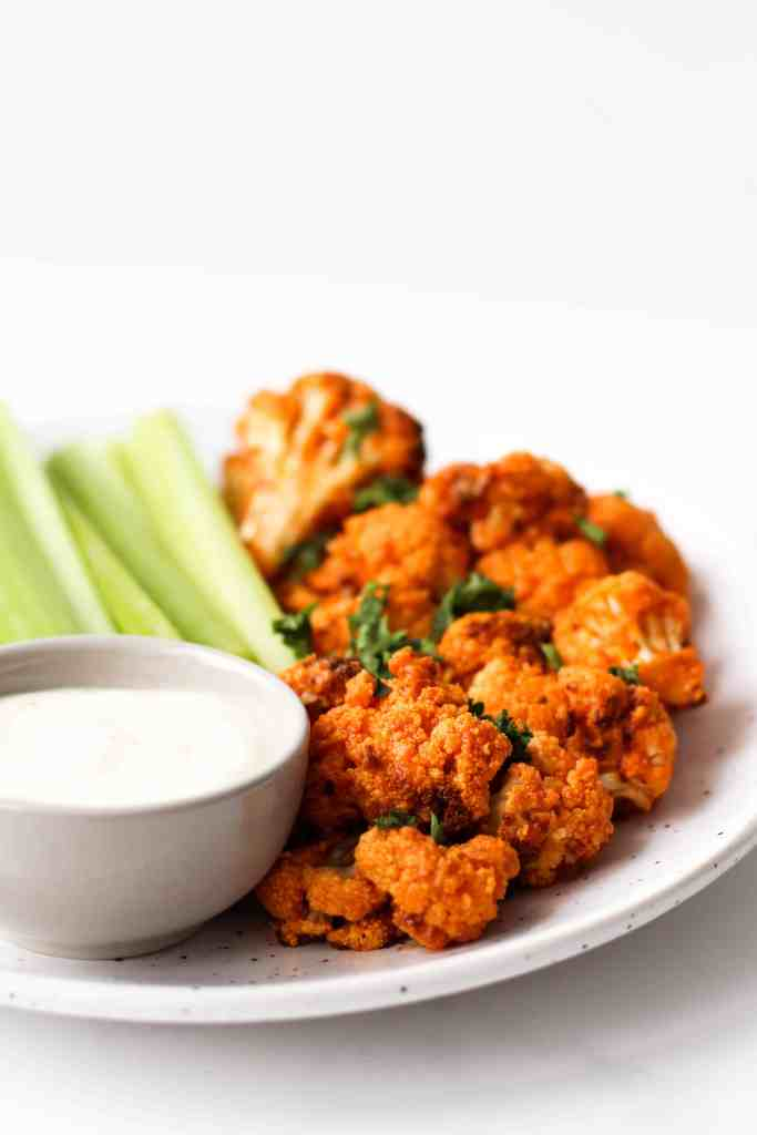 These vegan Buffalo Cauliflower Wings make a great healthy, gluten-free and plant-based appetizer or snack. An easy alternative to chicken wings!