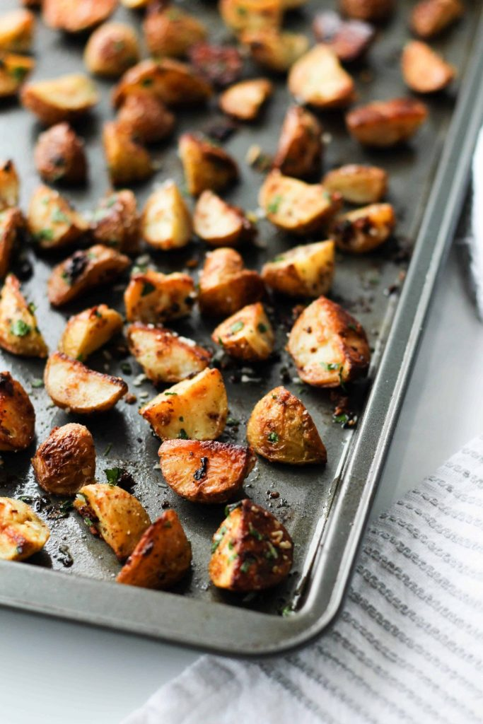 These Garlic Parmesan Roasted Potatoes are crispy, tender, and full of flavour! They're easy to throw together and pop in the oven for a delicious side dish.