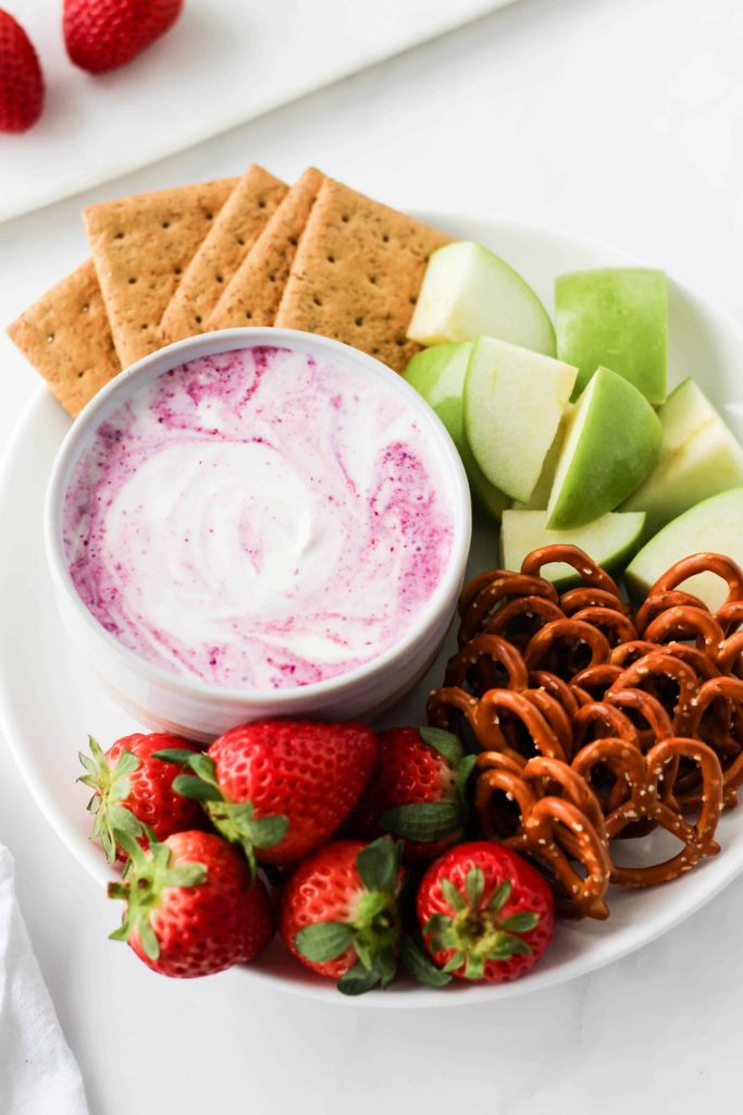 With just 5 ingredients you can make this simple, healthy cheesecake dip for fruit, graham crackers and more!