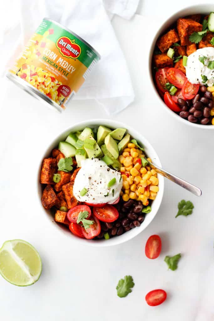 These Black Bean Sweet Potato taco bowls are the perfect meatless weeknight meal. They're packed with flavour, nutrition and are easily customizable!