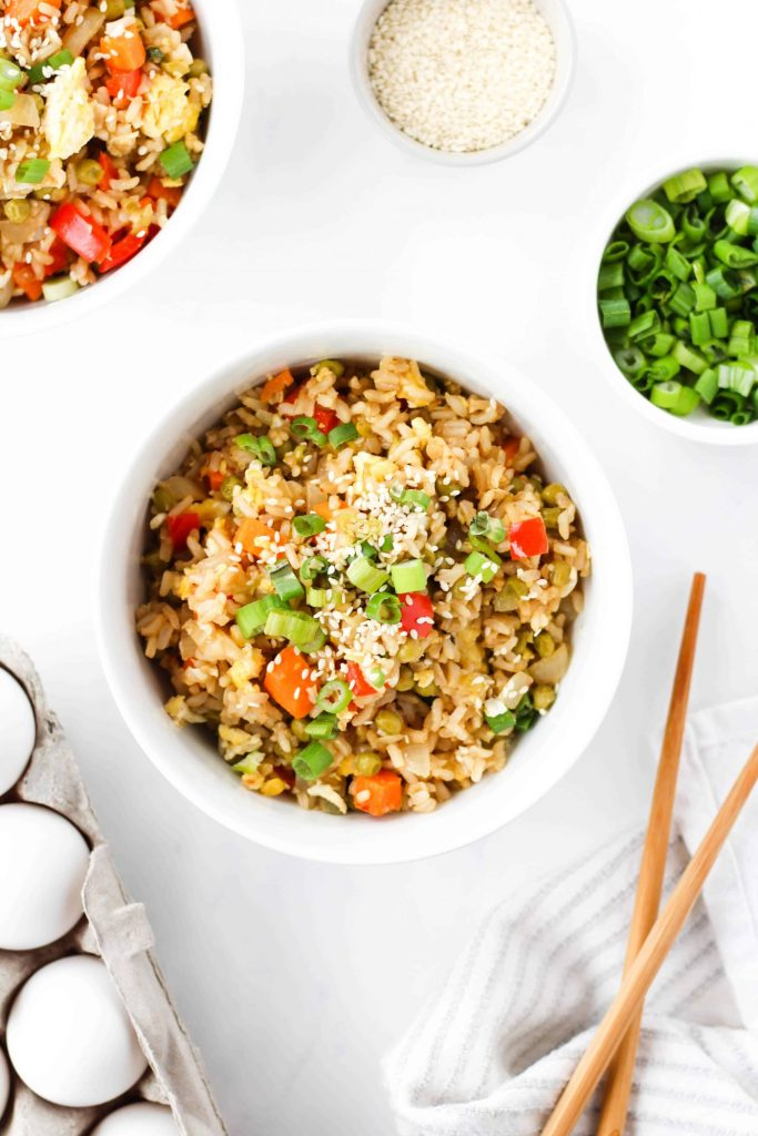 This vegetarian fried rice is a healthier take on traditional fried rice. Loaded with brown rice, plenty of veggies and quality protein from eggs! Enjoy this protein-rich vegetarian dish for dinner or as a side! Make it in 30 minutes or less for an easy weeknight meal.