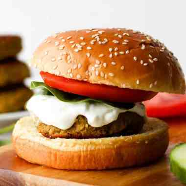 These Greek Chickpea Burgers are everything you need in a plant-based burger. They're nutritious, flavourful and delicious with creamy tzatziki sauce.
