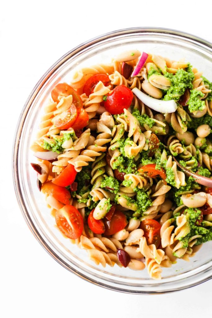 Calling all pesto lovers! You're going to love this Pesto Pasta Salad. It's a simple, crowd-pleasing recipe with creamy pesto, simple veggies and white beans for a protein boost.